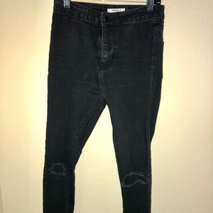 Black high-waist skinny jeans with holes